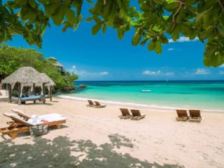 Save up to 50% on your accommodation at the Ultra-All-Inclusive Sandals Ochi Beach Resort & Spa
